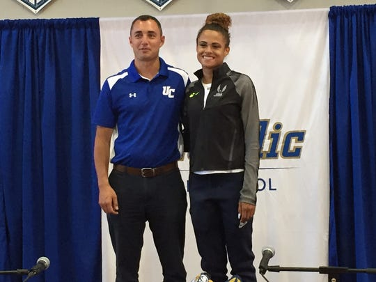 Sydney McLaughlin and coach Mike McCabe held a press