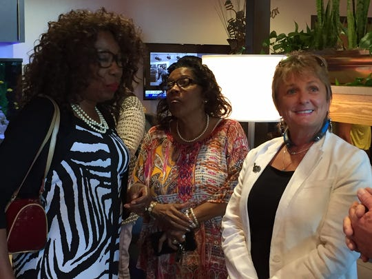 Monroe Councilwoman Juanita Woods (at left) and photographer Patti Stewart (at right) visit the new passenger lounge at the Monroe Regional Airport Friday.