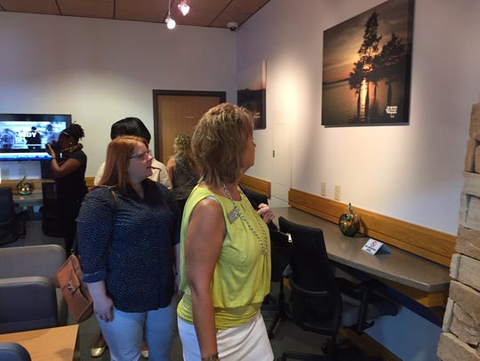 Guests tour the new Bayou Room Airport Lounge Friday.