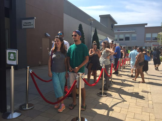 Some of the 100 people on line awaiting the opening of Shake Shack's Yonkers location in the Cross County Shopping Center, July 22, 2016.