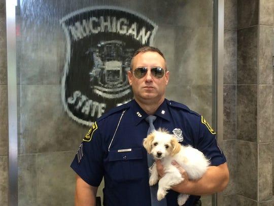 Trooper Christopher McIntosh rescued Stella, a Golden-Doodle,