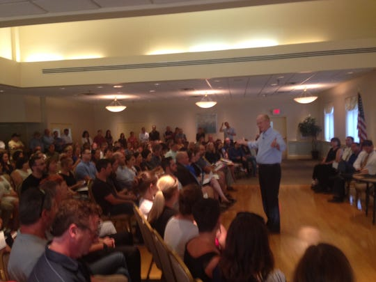 Collingswood Mayor James Maley speaks to the crowd at the town forum on Tuesday night.