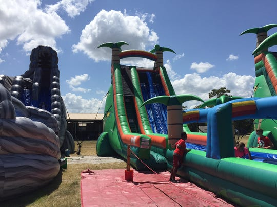 A tropical water slide was among the attractions for kids at Kid-A-Palooza Summer Splash held at Wickham Park on Saturday.