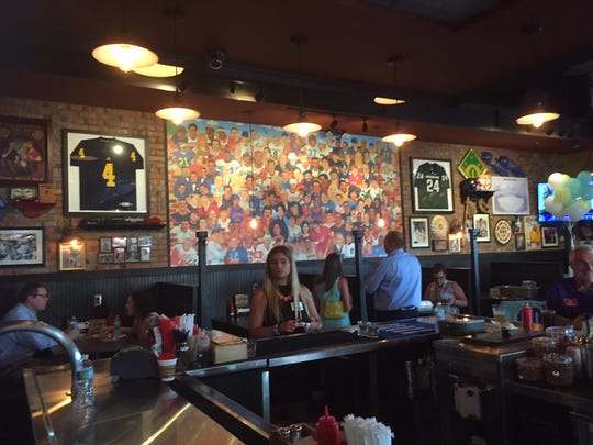 A large mural at the new Primanti Bros. in Taylor features local sports figures and celebrities.