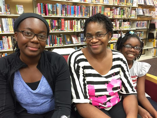 Maya (from left), Cheryl and Leyla Kpotufe live nearby and come to the Brightwood library frequently.