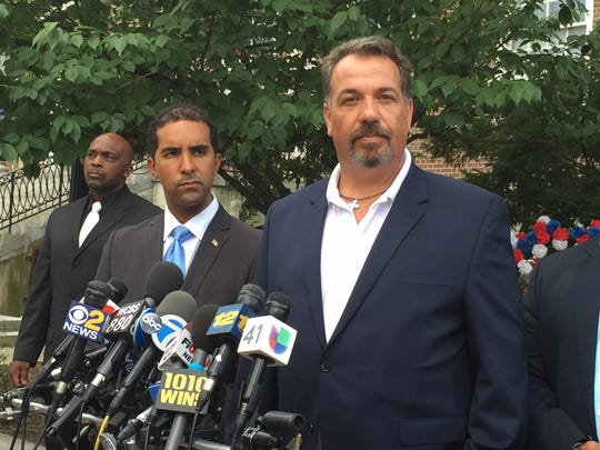 Mount Vernon police Commissioner Ronald Fatigate, right, speaks with the press outside City Hall on Aug. 5, 2016.