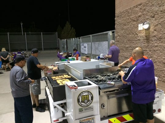 Members of the Shadow Hills booster club prepare breakfast for the more than 50 players and coaches that showed up for the team's first practice at midnight Aug. 8.