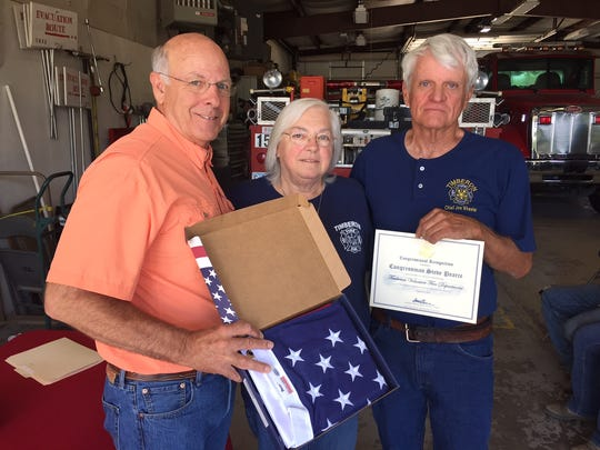 Pearce awards congressional certificates to members of the Timberon Volunteer Fire Department.
