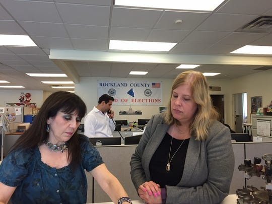 Rockland Board of Elections Republican Clerk Linda France, left, reviews the absentee ballot process with Rockland Democratic Elections Commissioner Kristen Zebrowski Stavisky on Aug. 10 at the Board of Elections in New City.