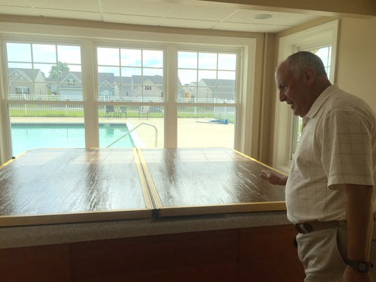 Odessa National resident Don Mueller walks through the project's community center on Monday. Work on the final 10 percent of the development can't proceed, frustrating residents who are eager to finalize their supervision of community amenities