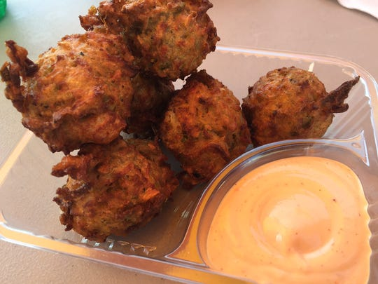 Crab fritters at the Iowa State Fair would be more accurate if they were called seafood fritters.