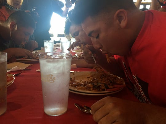 Desert Mirage's Jaime Serrano and Dylan Arreola try to wolf down some spicy Thai noodles Saturday.