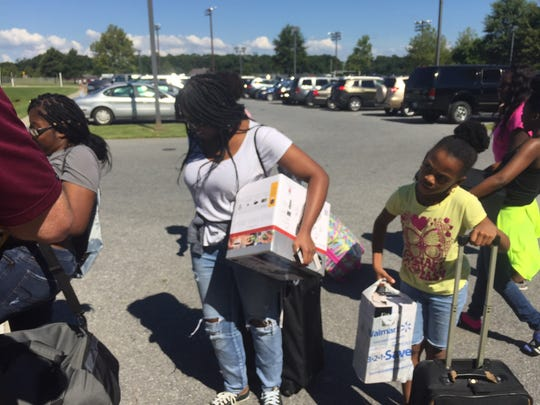 This Aug. 24, 2016 photo shows family members of a UMES freshman student hauling items to a dormitory on Move-In Day for freshmen and transfer students starting in the fall of 2016.