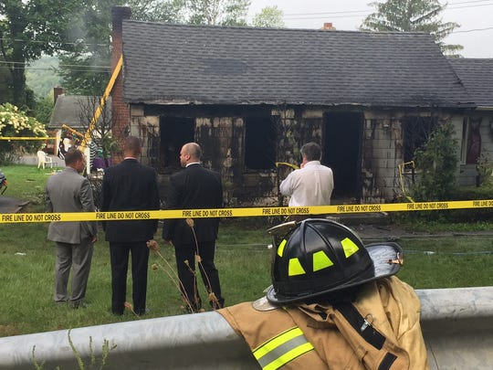 The aftermath of a house fire at 2 Maple Lane in Southeast