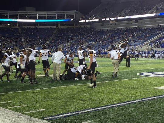 Southern Miss players react after a late turnover sealed the team's 44-35 win against Kentucky on Saturday.