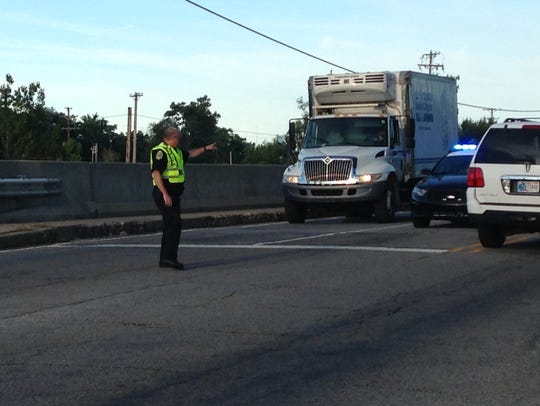 A  city of Muncie police officer directs traffic at