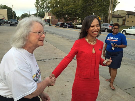 Lisa Blunt Rochester greets voters on the day she won the Democratic primary for Congress. If Rochester wins the November general election, she would be the Delaware's first female member of Congress.