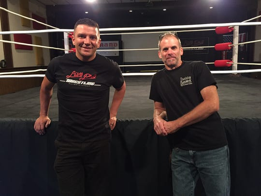 Tim Kralovic, left, and George Keller stand next to the Live Pro Wrestling ring at The Strand Theater, where superstars from the LPW promotion will be back in the ring Oct. 8.