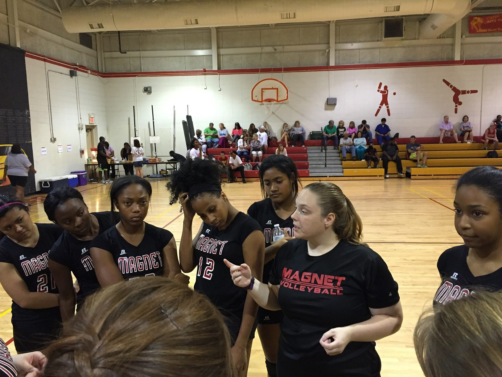 Caddo Magnet coach Amanda Dolph talks with her team prior to Tuesday's game with Captain Shreve.