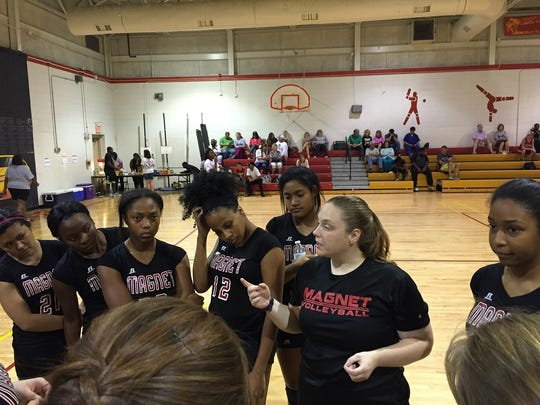 Caddo Magnet coach Amanda Dolph talks with her team