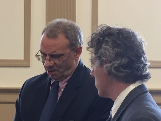 Wearing glasses, former Fenimore Landfill operator Richard Bernardi with defense lawyer Thomas Ambrosio in Superior Court, Morristown, on Sept. 21, 2016.
