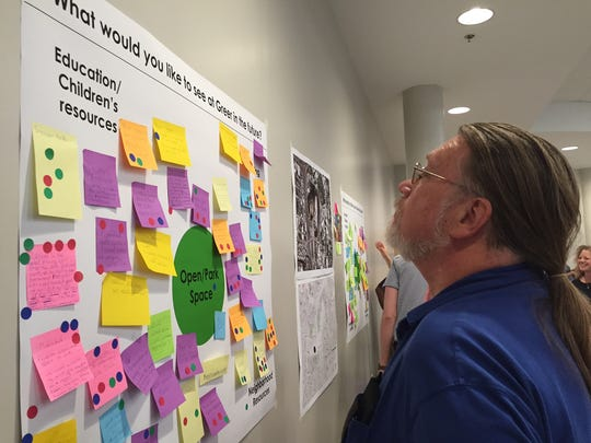 Nashville resident Eddie Jackson looks at ideas at a community meeting about the future of Greer Stadium.