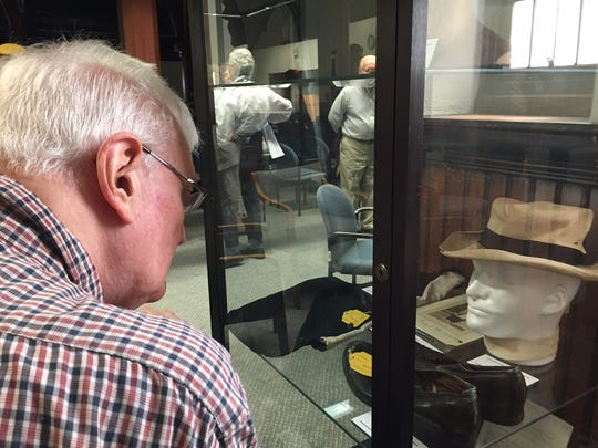 "Jack Denys of Somerville examines the exhibit on the Hall-Mills cold case in the Jury Room of the Somerset County Courthouse. The Heritage Trail Association offered a bus tour to reinvestigate the infamous double murder of Eleanor Mills and Rev. Edward Wheeler Hall. Sworn in by Sheriff Frank Provenzano, 50 newly minted ""detectives"" heard the evidence about the case and trial, toured the courtroom, discussed the case and tried to solve the mystery on Sunday."