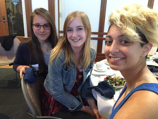 Juliette Barrere (from left), Mady Neal and Sonia DiOrio, seniors at the International School of Indiana, brought members of their Social Justice Club to the Game Changers Forum on Violence Against Women and Girls.