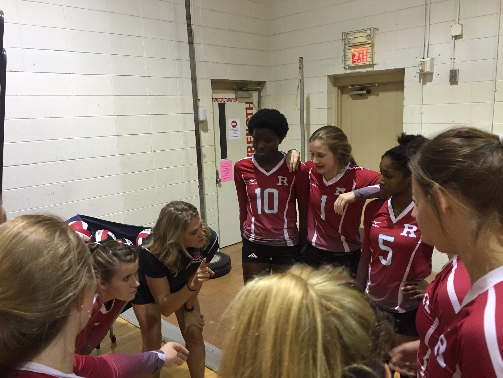 Ruston coach Amanda Cauley goes over points with her Lady Bearcats before their game Thursday at Caddo Magnet.
