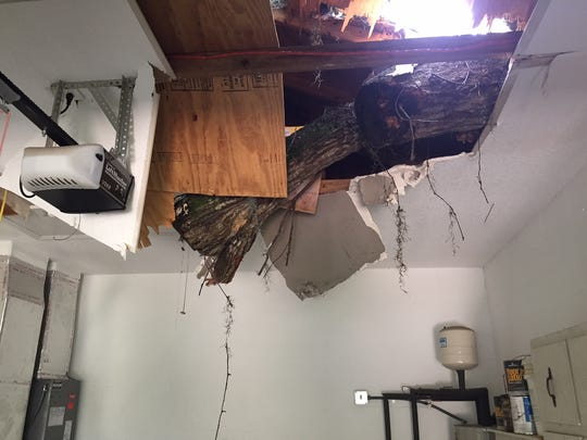A massive oak tree fell on the roof of a garage at a residence in Rockledge, piercing the roof of a garage at the residence.