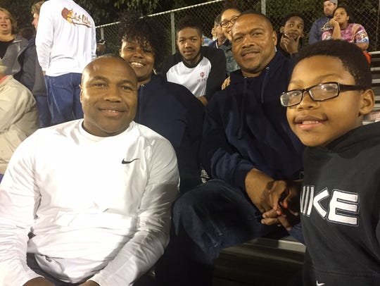 Members of the Tracy family in the stands at a Decatur
