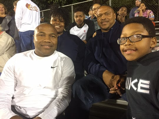 Members of the Tracy family in the stands at a Decatur Central game. Clockwise from left: Larry Tracy Jr., Laverna Tracy, Charles Turner V, Jasmine (Larry Jr's daughter, partly obscured), Tyrone Tracy Sr. and his youngest son. Javon.
