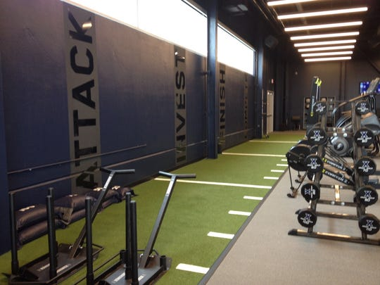 Custom flooring designed by PLAE allows Xavier athletes to work on speed and agility.
