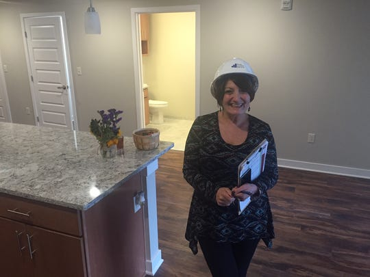Susan Lenzo of Charlotte Square shows one of the completed