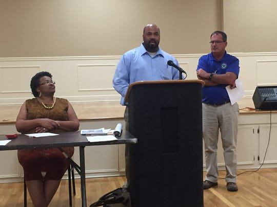 City Clerk Kermas Eaton, center, and Water and Sewer Director Chad Frierson, right, discuss water and sewer rates at Thursday's Ward 2 meeting.