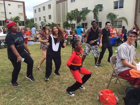 Aaliyah Frye (Elastigirl) of Palm Bay, 8, busts a move with some of the Florida Tech students at Treat or Treat on Oct. 29.