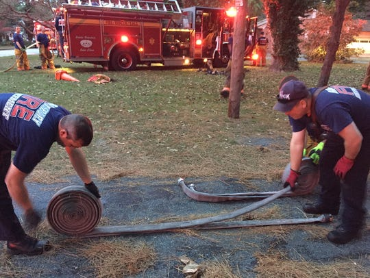 Salisbury firefighters roll up hoses  after house fire