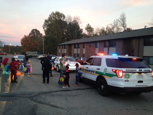 A Montgomery County Sheriff's deputy hands out candy