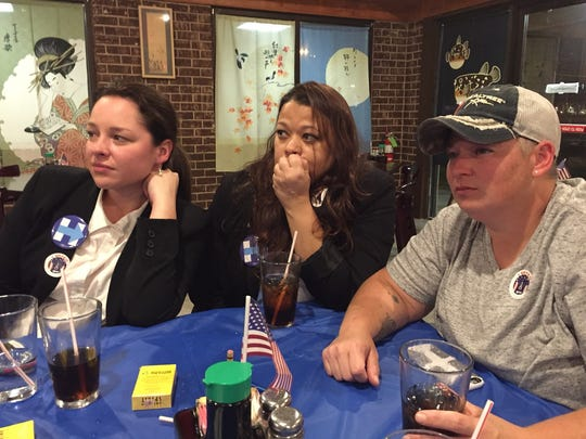 Jan Horner, E.J. Riche and Marissa Falicki watch with concern the electoral results.