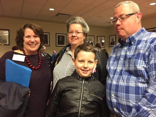 Department of Children and Families Commissioner Allison Blake celebrated with Liz and Michael Furey of Helmetta as they adopted their grandson and now son Dominic, 9. Fifteen families welcomed 18 new members as long-awaited adoptions were finalized during National Adoption Day at the Middlesex County Courthouse Tuesday.