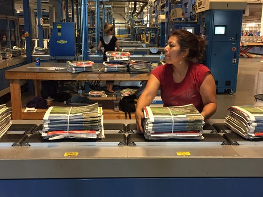 A Naples Daily News employee packages the Thanksgiving Day paper on Wed., Nov. 23, 2016.