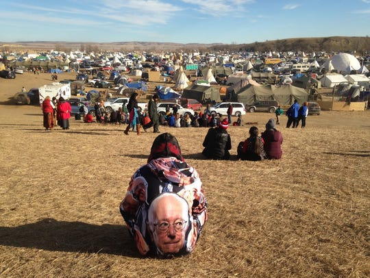 Protesters gather at an encampment on Saturday, Nov.