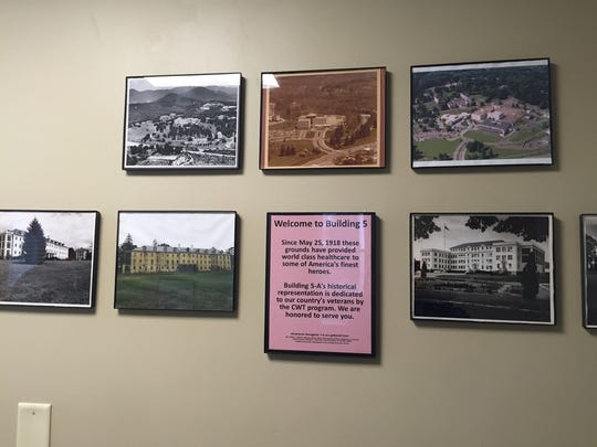 Historic photos hang inside the recently renovated building that houses the Charles George VA Medical Center's Compensated Work Therapy program.