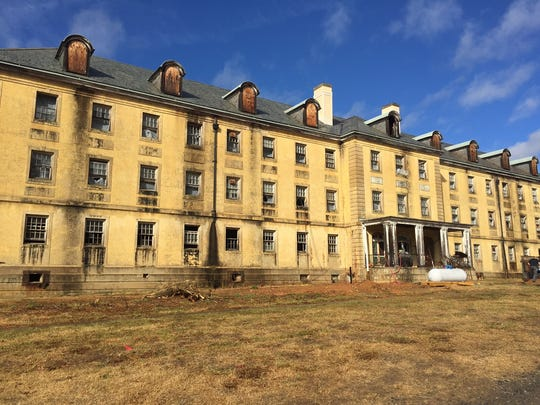 Construction crews are renovating the old nurses' dorm on the Charles George VA Medical Center campus. The building will eventually house outpatient mental health services.