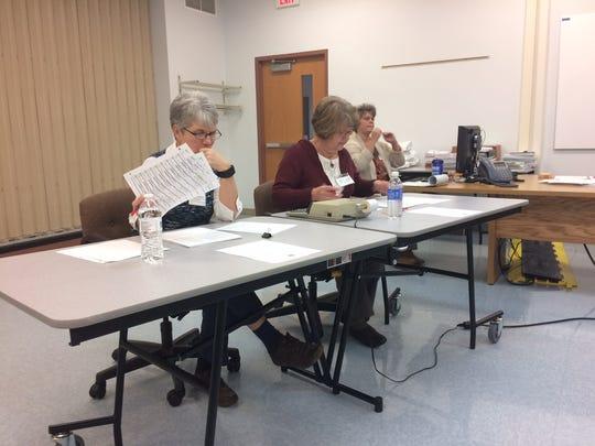 Door County tabulators Rosie Karas (left) and Ruth Kerscher review documents at the start of the recount.