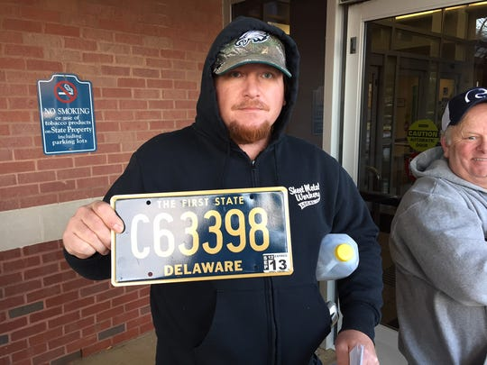 Dave Gerhardt, from Wilmington, was second in line to exchange his license plate for a low, five-digit tag in 2016.