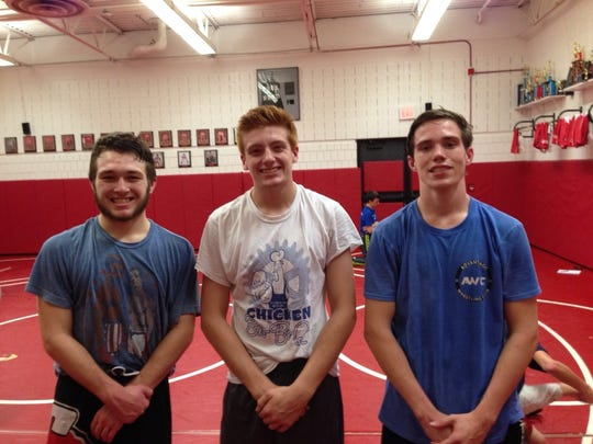 Canton's varsity wrestling co-captains are (from left)