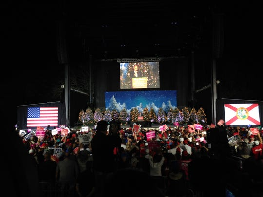 Crowd packed in to Dee Donald Trump, Michael Pance.