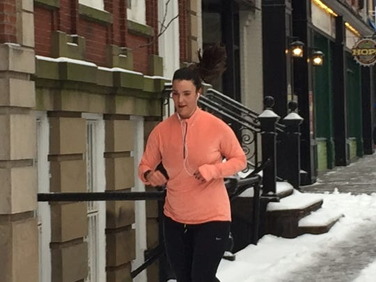 Claire Gray stuck to her running routine Dec. 17, 2016 despite freezing rain and snow in Morristown.