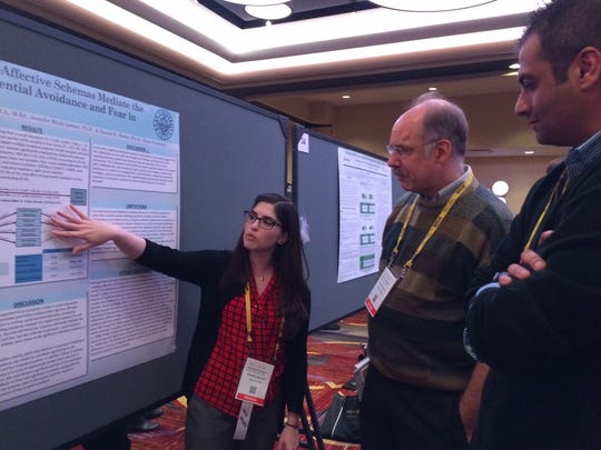 Kean University students, faculty, and alumni from the Doctor of Psychology (Psy.D.) program presented their original research at the ABCT 50th Annual Convention in late October. Pictured above (L-R): Kean Psy.D. student Arielle Bernstein from Palm Harbor, Florida. presents her research to American University Psychology Professor Anthony Ahrens, Ph.D. and Kean Psy.D. student Gautam Bhasin from Saddle River.